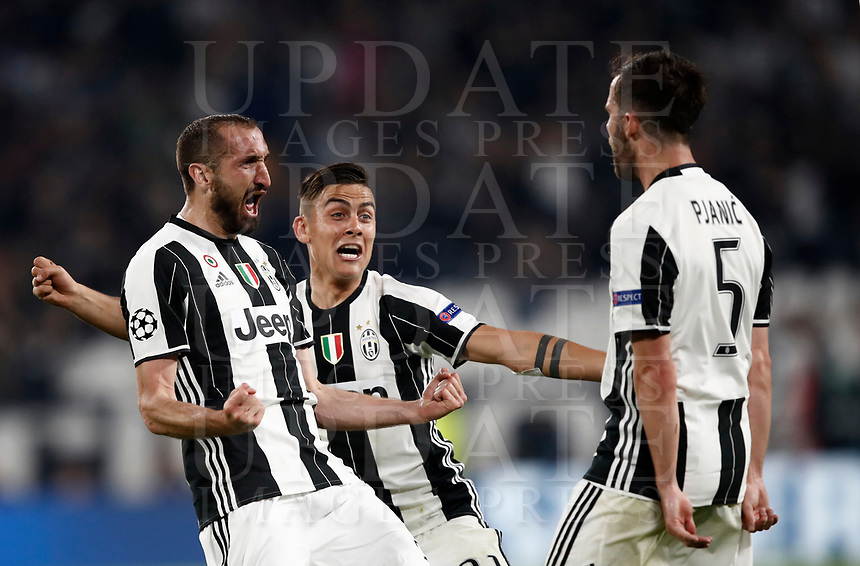 Football Soccer: UEFA Champions UEFA Champions League quarter final first leg Juventus-Barcellona, Juventus stadium, Turin, Italy, April 11, 2017. <br /> Juventus Giorgio Chiellini (l) celebrates with his teammates Paulo Dybala (c) and Miralem Pjanic (r) after scoring during the Uefa Champions League football match between Juventus and Barcelona at the Juventus stadium, on April 11 ,2017.<br /> UPDATE IMAGES PRESS/Isabella Bonotto