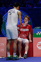 14th March 2020, Arena Birmingham, Birmingham, UK; Chinese Taipeis Chou Tien Chen hands Denmarks Anders Antonsens racquet as Antonsen retires injured during the mens singles semifinal match All England Badminton 2020 in Birmingham, Britain on March 14, 2020. Chou Tien Chen passed through to the final after Anders Antonsen retired