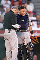 New York Yankees catcher Russell Martin #55 is looked at by Yankees trainer Gene Monahan after being hit  on the thumb during a game against the Los Angeles Angels at Angel Stadium on September 10, 2011 in Anaheim,California. Los Angeles defeated New York 6-0.(Larry Goren/Four Seam Images)