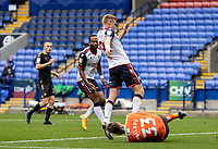 Bolton Wanderers' Eoin Doyle (left) competing with Oldham Athletic's goalkeeper Laurence Bilboe<br /> <br /> Photographer Andrew Kearns/CameraSport<br /> <br /> The EFL Sky Bet League Two - Bolton Wanderers v Oldham Athletic - Saturday 17th October 2020 - University of Bolton Stadium - Bolton<br /> <br /> World Copyright © 2020 CameraSport. All rights reserved. 43 Linden Ave. Countesthorpe. Leicester. England. LE8 5PG - Tel: +44 (0) 116 277 4147 - admin@camerasport.com - www.camerasport.com