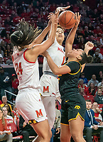 COLLEGE PARK, MD - FEBRUARY 13: Stephanie Jones #24 and Shakira Austin #1 of Maryland battle for the ball with Alexis Sevillian #5 of Iowa during a game between Iowa and Maryland at Xfinity Center on February 13, 2020 in College Park, Maryland.
