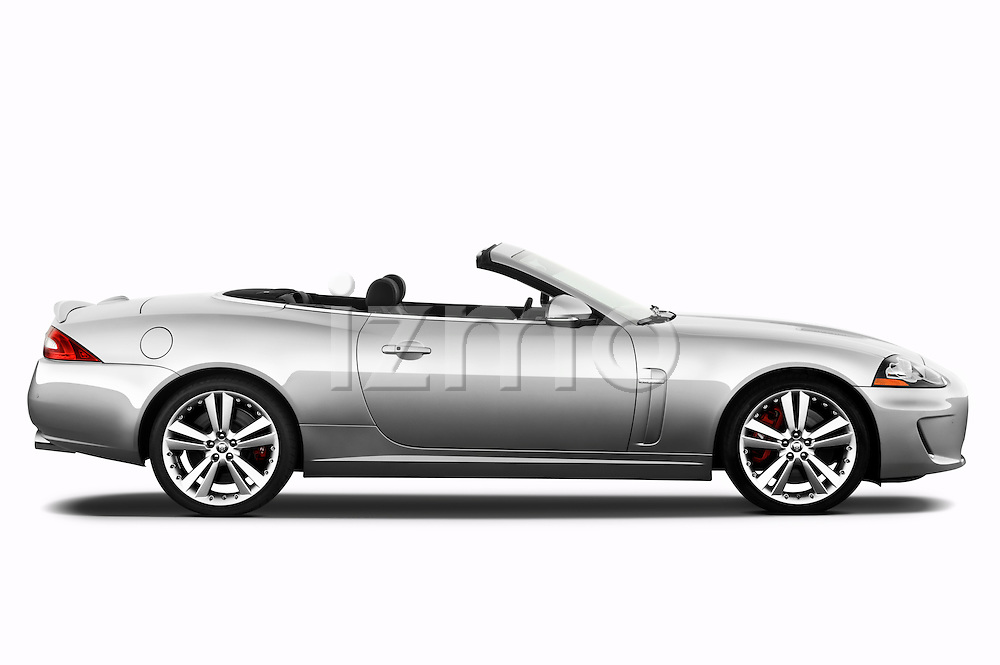 Passenger side profile view of a 2011 Jaguar XKR Convertible.