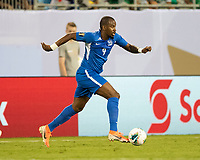 CHARLOTTE, NC - JUNE 23: Rodrigue Cesar #4 attacks during a game between Mexico and Martinique at Bank of America Stadium on June 23, 2019 in Charlotte, North Carolina.