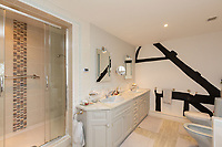 BNPS.co.uk (01202 558833)<br /> Pic: Savills/BNPS<br /> <br /> Pictured: A twin bathroom.<br /> <br /> A historic thatched home where Cromwell's army stayed during the English Civil War is on the market for £1.6m.<br /> <br /> The Barracks, so-named for its links with Cromwell more than 370 years ago, has spectacular country views and is in one of Cheshire's most popular areas.<br /> <br /> The five-bedroom property just outside the picturesque village of Bunbury is a far cry from how it would have looked in Cromwell's time, having been extended over the years.<br /> <br /> It was used in the 17th century by Cromwell's armies during the siege of Beeston Castle - two miles away. The castle's location made it valuable to both the royalists and parliamentarians.