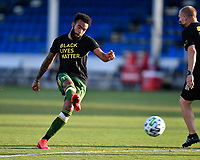 LAKE BUENA VISTA, FL - JULY 18: Eryk Williamson #30 of the Portland Timbers takes a shot during a game between Houston Dynamo and Portland Timbers at ESPN Wide World of Sports on July 18, 2020 in Lake Buena Vista, Florida.