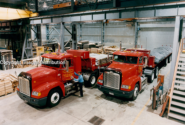 August 30, 1998, Laval, Quebec, Canada<br /> <br /> A delivery truck friver get ready to leave with a load of steel sheets at Alliance Steel warehouse in Laval, Canada.  In a model & property released photo.<br /> <br /> THe European Union , the World Commerce Organisation as well as many countries  reacted stronly today, March 5th 2002 after the annonce by US Preseident Bush of a 30 % tax on steel importation into the US, to protect it's steel industry.<br /> only Canada, Mexico and 2 other countries are exempt from this tax<br /> <br /> Mandatory Credit: Photo by Pierre Roussel- Images Distribution. (©) Copyright by Pierre Roussel <br /> ON SPEC<br /> NOTE: scan from an 8x10 print of a 2 1/4 negative ,saved in Adobe 1998 RGB.