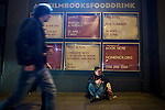 © Joel Goodman - 07973 332324 . 04/04/2015 . Manchester , UK . Neil , a homeless man sitting outside the Corner House on its closing night . He says those who run the Corner House have given him shelter and support on several occasions through the years . Final party at the Corner House 's historical location on Oxford Road , before moving to First Street under a new name . Featuring several dance floors , drag queens , dance and performance art displays . Photo credit : Joel Goodman