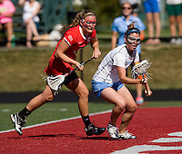 Megan Bosica (2) of North Carolina takes control of the ball in front of Libby Johnson (44) of Cornell at St. Stephens and St. Agnes High School in Alexandria, VA.  North Carolina defeated Cornell, 13-7.