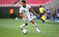 ZAPOPAN, MEXICO - MARCH 21: Sebastian Saucedo #10 of the United States dribbles the ball during a game between Dominican Republic and USMNT U-23 at Estadio Akron on March 21, 2021 in Zapopan, Mexico.