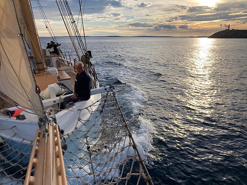Evening arrival. Still carrying the soldier's breeze which has favoured her all the way from Galway, Ilen comes in round the Old Head of Kinsale. Photo: Ilen Marine School