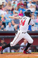 Hector Gomez (14) of the Nashville Sounds follows through on his swing against the Oklahoma City RedHawks at Greer Stadium on July 25, 2014 in Nashville, Tennessee.  The Sounds defeated the RedHawks 2-0.  (Brian Westerholt/Four Seam Images)
