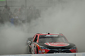 #20: Christopher Bell, Joe Gibbs Racing, Toyota Camry Rheem celebrates with a burnout after winning
