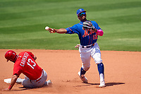 New York Mets shortstop Francisco Lindor (12) turns a double play as Matt Carpenter (13) slides into second base during a Major League Spring Training game against the St. Louis Cardinals on March 19, 2021 at Clover Park in St. Lucie, Florida.  (Mike Janes/Four Seam Images)