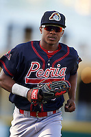 Peoria Chiefs outfielder Magneuris Sierra (19) jogs to the dugout during a game against the Lansing Lugnuts on June 6, 2015 at Cooley Law School Stadium in Lansing, Michigan.  Lansing defeated Peoria 6-2.  (Mike Janes/Four Seam Images)