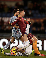 Calcio, ottavi di finale di Tim Cup: Roma vs Sampdoria. Roma, stadio Olimpico, 19 gennaio 2017.<br /> Sampdoria's goalkeeper Christian Puggioni, bottom, grabs the ball past his teammate Bartosz Bereszynski, left, and Roma's Edin Dzeko during the Italian Cup round of 16 football match between Roma and Sampdoria at Rome's Olympic stadium, 19 January 2017.<br /> UPDATE IMAGES PRESS/Isabella Bonotto