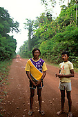 Mato Grosso, Brazil. Rikbaktsa (Canoeiro) Indian man in Brazilian flag motif t-shirt and his son.