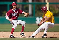 LOS ANGELES, CA - April 10, 2011: Lonnie Kauppila of Stanford baseball tags out the runner before throwing to first to complete the double play during Stanford's game against USC at Dedeaux Field in Los Angeles. Stanford lost 6-2.