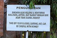 Bali, Indonesia.  +Sign Warning to be Alert for Monkeys.  Kecak Dance, Arena adjacent to Uluwatu Temple.