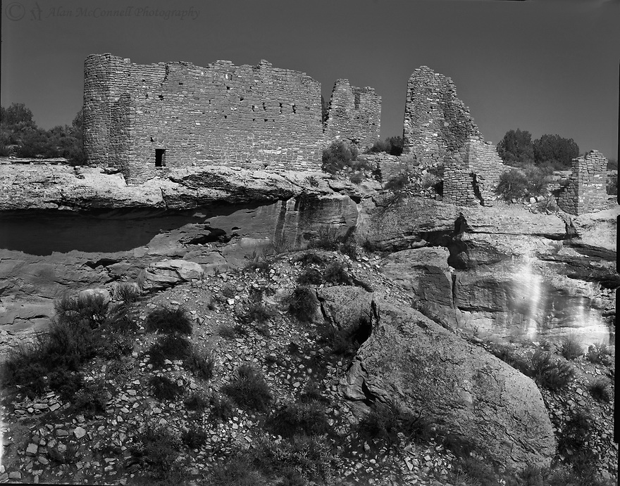 """""""Hovenweep Castle""""<br /> Hovenweep, Utah<br />  2010<br /> Hovenweep National Monument was established in 1923.  This national monument was designated because of the unusual architecture and state of preservation of the ancestral Puebloan structures.  Usually, most ruins are found protected under a cliff face of some canyon, such as those found at Mesa Verde.  Several well-preserved towers can be found along Little Ruin Canyon.  Hovenweep Castle was probably built around 1200 a.d.  Sitting at the precipice of the canyon, this grand structure overlooks the two-story Square Tower, which sits at the bottom of the canyon.<br /> <br /> 4x5 Large Format Film"""