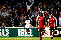 US midfielder Clint Dempsey (8) celebrates after scoring the USA's second goal.  The U.S. Men's National Team defeated Trinidad & Tobago 3-0 at Toyota Park in Bridgeview, IL on September 10, 2008.