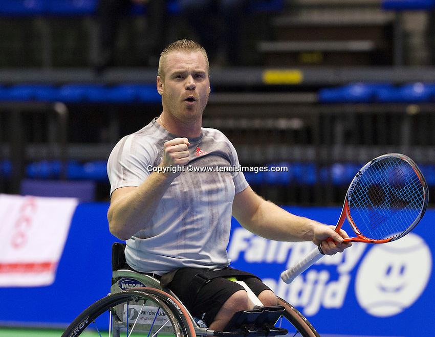 Rotterdam, Netherlands, December 20, 2015,  Topsport Centrum, Lotto NK Tennis, Final mens wheelchair Maikel Scheffers (NED) winner jubilates<br /> Photo: Tennisimages/Henk Koster
