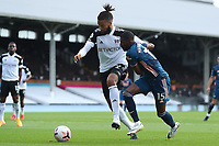 12th September 2020; Craven Cottage, London, England; English Premier League Football, Fulham versus Arsenal; Michael Hector of Fulham competes for the ball with Ainsley Maitland-Niles of Arsenal