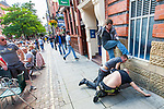 © Joel Goodman - 07973 332324 . 23/07/2011 . Manchester , UK . EDL supporter STEPHEN WOOLRIDGE (centre of fight) and two other men . Anti-fascists and EDL supporters fight on Canal Street in Manchester's Gay Village . The EDL's Gay Division cancelled a protest, planned for 23rd July 2011 in Manchester's Gay Village . Despite the cancellation, two supporters of the protest and anti-fascist counter-protesters attended and a fight ensued . Photo credit : Joel Goodman