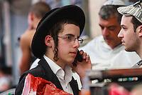 Israel,Jerusalem, an orhodox jude boy portrait in   the Mahane Yehuda Open Air Food Market,