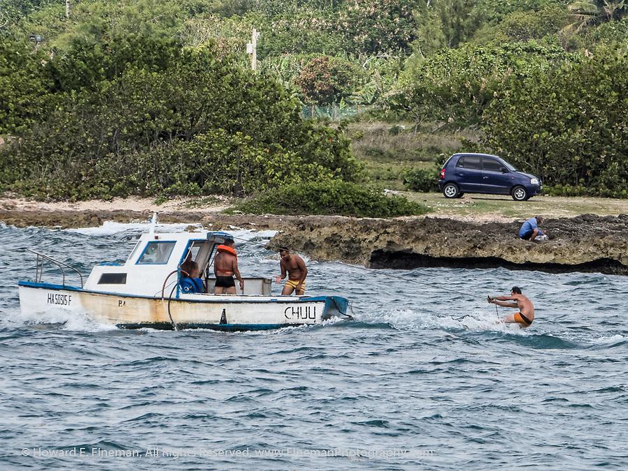 Waterskiing from fishing boat in Cojimar harbor