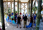 SHELL POINT, FL - OCTOBER 14: Pastor Gary Pritchett leads the prayer during church service under the Seafarers Chapel at Shell Point that was displaced after Hurricane Michael on October 14, 2018 in Crawfordville, Florida. (Photo by Mark Wallheiser/Getty Images)