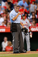 Home plate umpire Dale Scott during a game between the Los Angeles Angels and the St. Louis Cardinals at Angel Stadium on July 3, 2013 in Anaheim, California. (Larry Goren/Four Seam Images)
