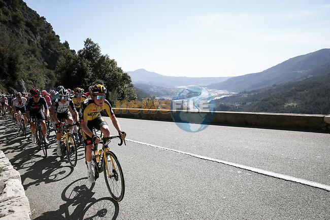 The peloton climb the Côte de Gilette during Stage 7 of Paris-Nice 2021, running 119.2km from Le Broc to Valdeblore La Colmiane, France. 13th March 2021.<br /> Picture: ASO/Fabien Boukla | Cyclefile<br /> <br /> All photos usage must carry mandatory copyright credit (© Cyclefile | ASO/Fabien Boukla)