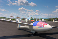 Sailplanes are positioned on the takeoff grid waiting for their first launch of the day on day 5 of the 2013 Region 3 Soaring contest at Harris Hill Gliderport in Elimira, New York.