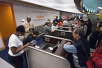 Customers line up at the ticket counter for Skybus Airlines on the first day of the airline's flights from Columbus, Ohio, hub.  Skybus Airlines Inc., will compete with Southwest Airlines Co., JetBlue Airways Corp. and other low-cost companies.