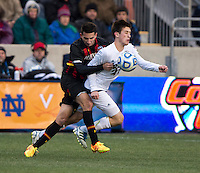 Dan Metzger (7) of Maryland fouls Patrick Hodan (27) of Notre Dame  during the NCAA Men's College Cup final at PPL Park in Chester, PA.  Notre Dame defeated Maryland, 2-1.