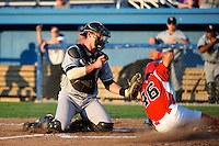 Staten Island Yankees catcher Peter O'Brien #52 tags out Breyvic Valera #46 sliding into home during a game against the Batavia Muckdogs at Dwyer Stadium on July 30, 2012 in Batavia, New York.  Batavia defeated Staten Island 5-4 in 11 innings.  (Mike Janes/Four Seam Images)