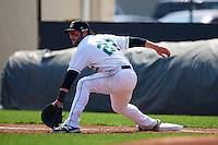 Clinton LumberKings first baseman Pat Leyland (23) stretches for a throw during a game against the Great Lakes Loons on August 16, 2015 at Ashford University Field in Clinton, Iowa.  Great Lakes defeated Clinton 3-2.  (Mike Janes/Four Seam Images)