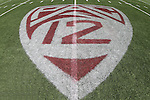 Pac-12 logo on the field turf at Martin Stadium, photographed during a 2012 Spring football practice at Washington State University under new head football coach, Mike Leach.