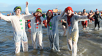 Pictured: A group of young people in snowman take to the freezing cold sea in Tenby, west Wales, UK. Monday 26 December 2016<br /> Re: Hundreds of people in fancy dress, take part in this year's music-themed charity event, the Boxing Day Swim in Tenby, Pembrokeshire, Wales, UK