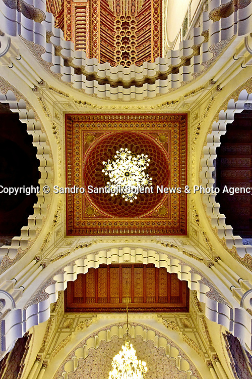 Pictured: The Hassan II Mosque in Casablanca, Morocco<br /> <br /> A series of photographs of ceilings from historic buildings show off kaleidoscopic patterns.  Italian photographer Sandro Santioli captured the mesmerising and intricately decorated interiors of some of Istanbul's grandest places of worship.<br /> <br /> The symmetry of the designs adorning ceilings in Topkapı Palace, Sultan Ahmed Mosque and Hagia Sophia Grand Mosque create kaleidoscopic patterns.  As well as Istanbul, Turkey, Mr Santioli photographed ceilings at the Amber Fortress in Jaipur, India.  SEE OUR COPY FOR DETAILS. <br /> <br /> Please byline: Sandro Santioli/Solent News<br /> <br /> © Sandro Santioli/Solent News & Photo Agency<br /> UK +44 (0) 2380 458800