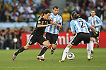 03.07.2010, CAPE TOWN, SOUTH AFRICA, Mesut Oezil of Germany attempts to get past Javier Mascherano of Argentina and Martin Demichelis of Argentina  during the Quarter Final, 59 of the 2010 FIFA World Cup, Argentina vs Germany held at the Cape Town Stadium Foto © nph / Kokenge
