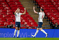 8th Occtober 2020, Wembley Stadium, London, England;  Englands Conor Coady celebrates with team mates Keane after scoring his goal during a friendly match between England and Wales in London
