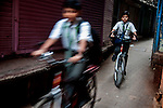 Boys going to school through one of the innumerable lanes in Varanasi, Uttar Pradesh, India.