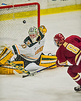 20 February 2016: University of Vermont Catamount Goaltender Packy Munson, a Freshman from Hugo, MN, has the puck sail over the crossbar after making a third period save against the Boston College Eagles at Gutterson Fieldhouse in Burlington, Vermont. The Eagles defeated the Catamounts 4-1 in the second game of their weekend series. Mandatory Credit: Ed Wolfstein Photo *** RAW (NEF) Image File Available ***