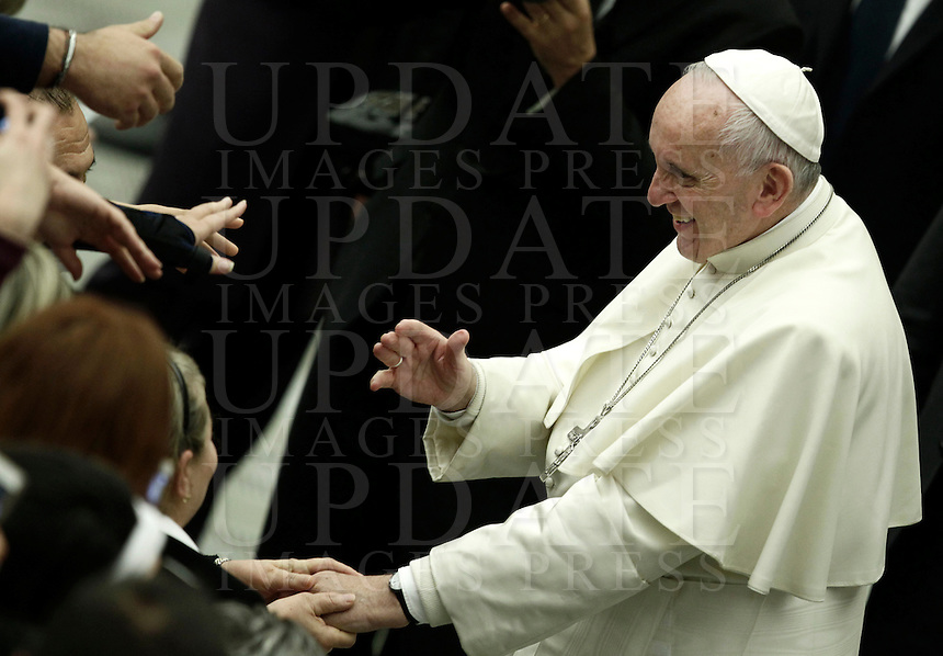 Pope Francis touches hands with people in the crowd at the and of an audience with young volunteers from Italy's National Civil Service in Paul the VI hall at the Vatican, on November 26, 2016.<br /> UPDATE IMAGES PRESS/Isabella Bonotto<br /> <br /> STRICTLY ONLY FOR EDITORIAL USE