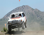 STURGIS, SD - JUNE 13: Joachim Schwiesow runs the course with Bear Butte as a backdrop during the Stock-Mod class during the Liberty Super stores/Dakota Customs 250 short course baja race at the Buffalo Chip.  (Photo by Dick Carlson/Inertia)