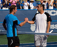 David Nalbandian shakes hands with Marcos Baghdatis during the Legg Mason Tennis Classic at the William H.G. FitzGerald Tennis Center in Washington, DC.  David Nalbandian defeated Marcos Baghdatis in straight sets in the finals Sunday afternoon.