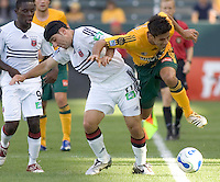LA Galaxy Midfielder Nathan Sturgis battles with DC United Forward Alecko Eskandarian. LA Galaxy tied DC United 1-1 during a MLS game at The Home Depot Center in Carson, California Sunday June 11, 2006.