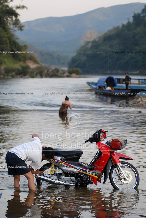 LAO PDR, Muang Khua at Nam Ou river , a branch of Mekong river , washing of scooter