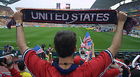 An United States Men's National soccer team supporter holds up a team scarf before the World Cup first round match between the USA and Portugal at Suwon World Cup stadium in Suwon, South Korea.